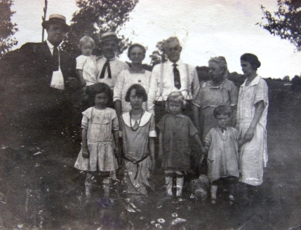 Standing l to r: James Williams, Tom Williams holding son Robet, Isabel his wife, Daniel Williams, Jane Price Williams his wife and Emma Susan Whetstone Williams. Children l to r: Lois and Hilde Dau of Tom and Isabel, Virginia and Dorothy dau of Emma and Camey